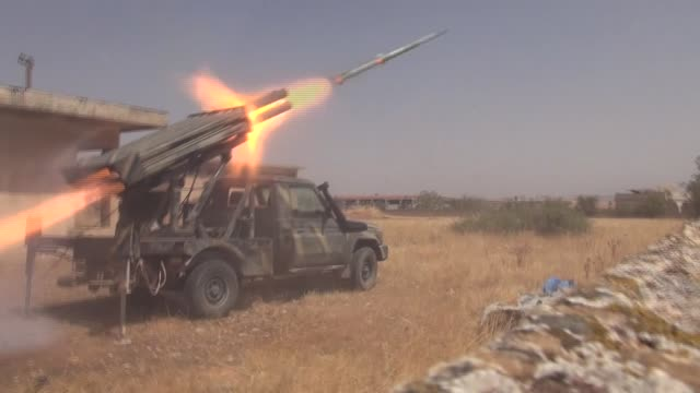syrian oppositions launch missile attacks on regime-controlled al-nayrab airbase in aleppo, syria on august 23, 2016. - howitzer stock videos & royalty-free footage