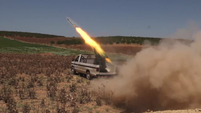 syrian oppositions launch rocket attack on regime-controlled nahl checkpoint in sqailbiya town, near hama, syria on may 30, 2016. - howitzer stock videos & royalty-free footage