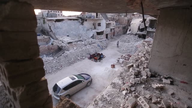 syrian orphans gathered amongst the rubble in a severely bombdamaged idlib street on wednesday to break their ramadan fast and enjoy an iftar dinner... - ramadan stock videos & royalty-free footage