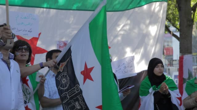 Syrian people protesting in Paris France against Bashar AlAssad actions