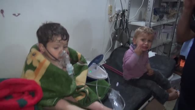 Syrian people receives treatment at a field hospital following a suspected chlorine gas attack by Assad regime forces in Mishmishan village of Jisr...