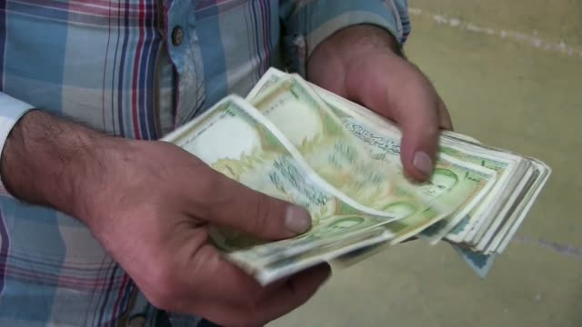 syrian pounds - banknote stock videos & royalty-free footage