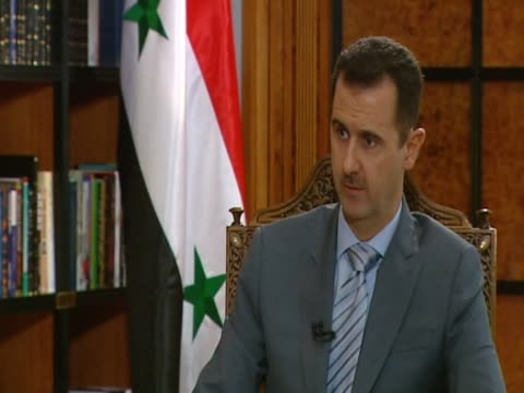 syrian president bashar al assad on the use of the army - バッシャール・アル=アサド点の映像素材/bロール