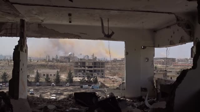 Syrian rebel fighters launch attacks against Syrian regime forces and destroy a building used as a military base by regime forces in Jamiat alZahraa...