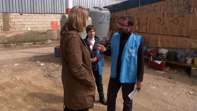 syrian refugee crisis: amber rudd visits lebanese refugee camp; amber rudd mp along with mireille girard and others / amber rudd chatting with aid... - tricycle stock videos & royalty-free footage