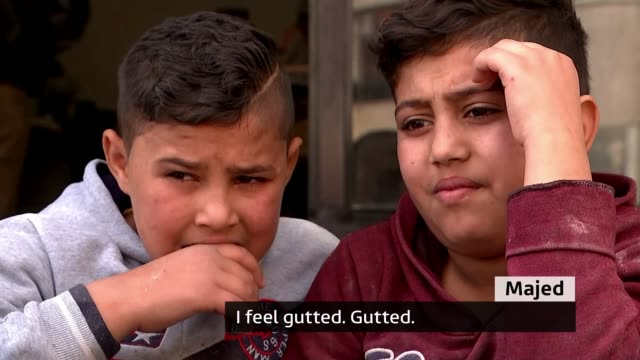 'lost generation' of refugee children missing out on education LEBANON Beqaa Valley INT Various shots of two young Syrian refugee boys working in...