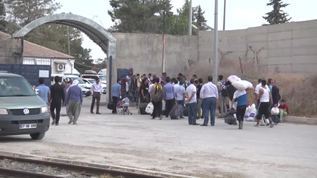 Syrian refugees arrive at the Karmakis border gate to cross into Syrian town of Jarablus after it was cleared from Daesh terrorist group as part of...
