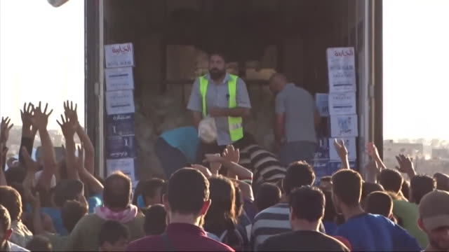 syrian refugees being provided with food on the border with jordan - refugee stock videos & royalty-free footage
