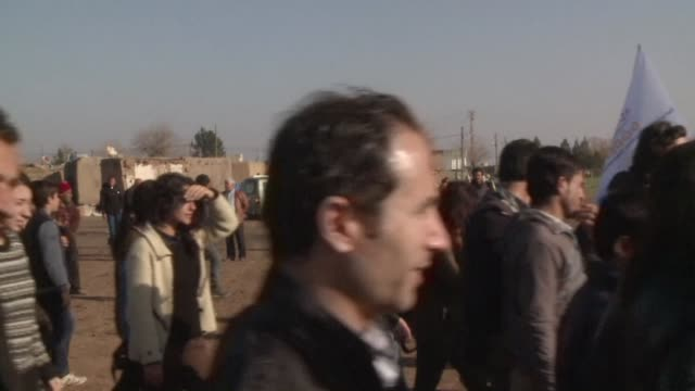 syrian refugees from kobane who flow into turkey's largest refugee camp, celebrated on sunday the kurdish fighters' success in recapturing the key... - jihad stock videos & royalty-free footage