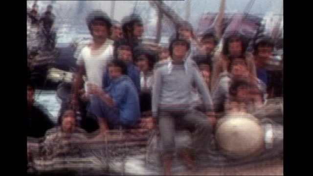 Government confirms it will accept 'several hundred' of the most vulnerable victims S30100607 Various of Vietnamese boat people crammed in...