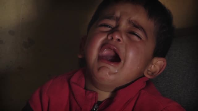syrian refugees in bekaa region of lebanon suffer from cold weather and hard living conditions on 16 january 2015 an orphan refugee child lara who is... - orphan stock videos & royalty-free footage