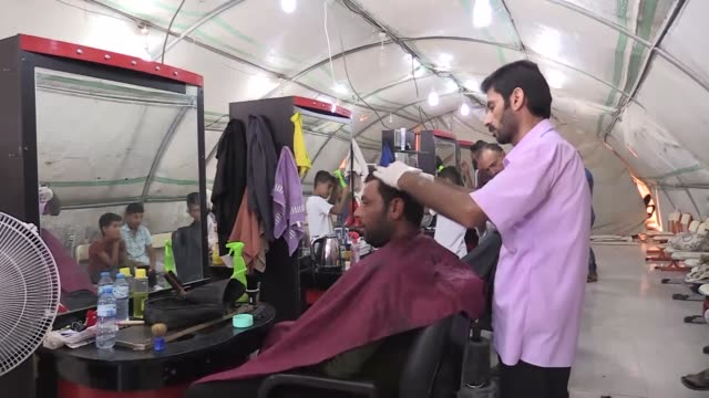 syrian refugees make preparations for the upcoming eid aladha festival at a refugee camp in akcakale district of sanliurfa province southeastern... - vermischtes stock-videos und b-roll-filmmaterial