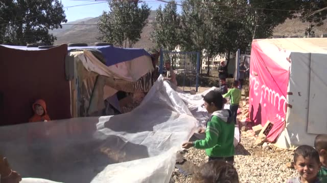 syrian refugees seen among makeshift tents at a syrian refugee camp in the town of qabb ilyas in lebanon's beqaa valley on november 10 2016 for many... - lebanon country stock videos & royalty-free footage