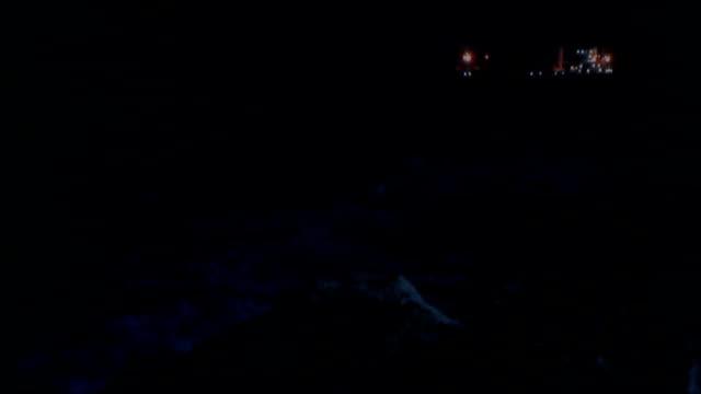 vídeos de stock, filmes e b-roll de syrian refugees smuggling from turkish ports turkey mersin ext / night various shots waves crashing on shore and buildings along coast at night moon... - smuggling
