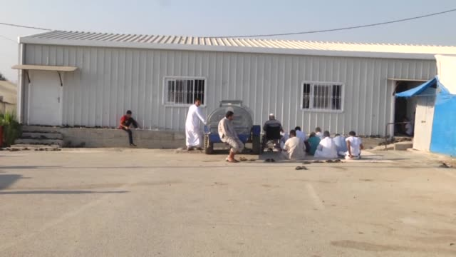 syrian refugees spend their ramadan holiday at refugee camps and perform eid el-fitr prayer at tent camp of boynuyogun accommodation facilities in... - holiday camp stock videos & royalty-free footage