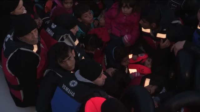 vídeos de stock e filmes b-roll de syrian refugees who tried to go to greek island chios are seen in a boat after they were caught by turkish coast guard ship tcsg umut near the... - crise de migrantes europeia 2015 2016