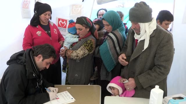 syrian refugees who work as seasonal workers undergo medical examination as part of a project run by izmir public health directorate doctors... - izmir stock videos & royalty-free footage