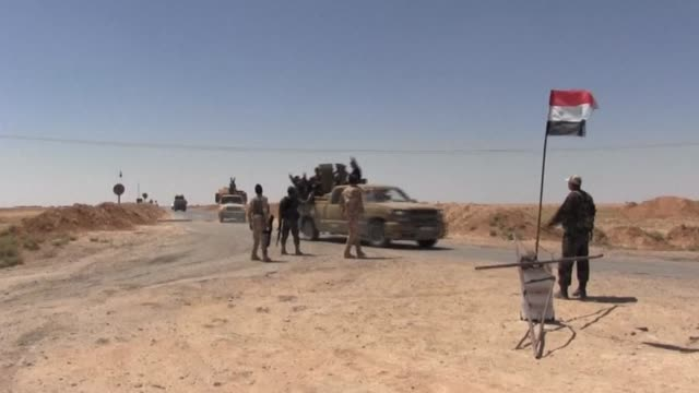 Syrian regime forces were patrolling on Sunday on the road leading to al Rasafa village south of Islamic State group held Raqa after they retook the...