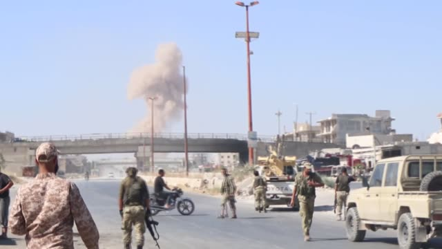 syrian regime launches airstrikes on maarat al-numan town as a convoy of turkish military vehicles passes through the town on august 19, 2019 in... - 空爆点の映像素材/bロール