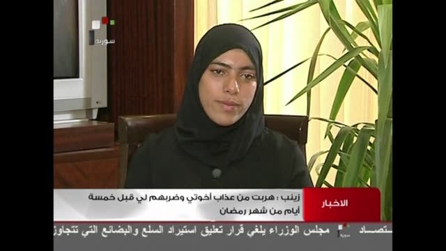 Syrian state television has aired an interview with a woman who had reportedly been found decapitated armless and skinned in a morgue last month amid...