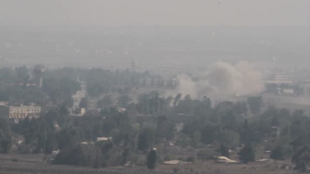 Syrian troops battled rebels hard by the armistice line with Israel on the Golan Heights on Monday