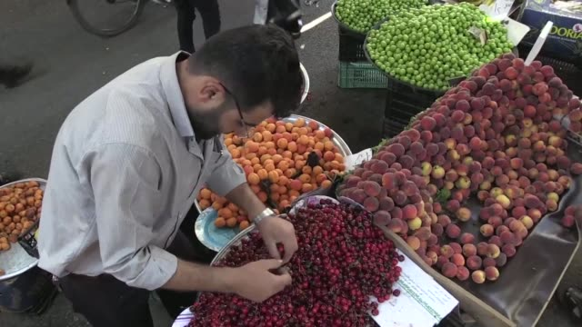 syrian vendors and shoppers visit damascus' bab srija market during the muslim holy fasting month of ramadan as they suffer from rising prices of... - fare video stock e b–roll