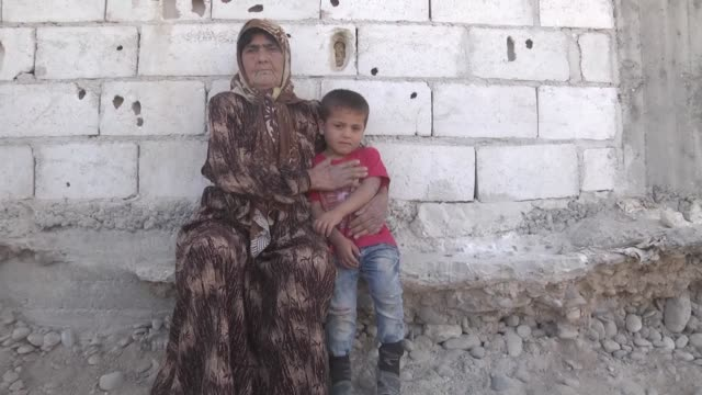 Syrian Zainab Omar who fled a northern Syrian village with her two daughters in law and grandchildren due to PYD attacks take shelter in Aleppo's...