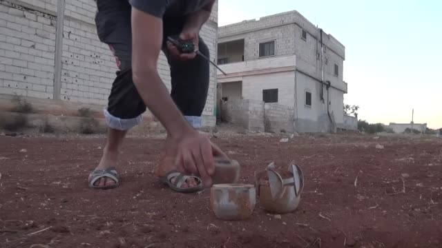 Syrians carry woundeds to field hospital after war crafts belonging to Russian army carried out an cluster bomb attack on residential ares in Idlib...