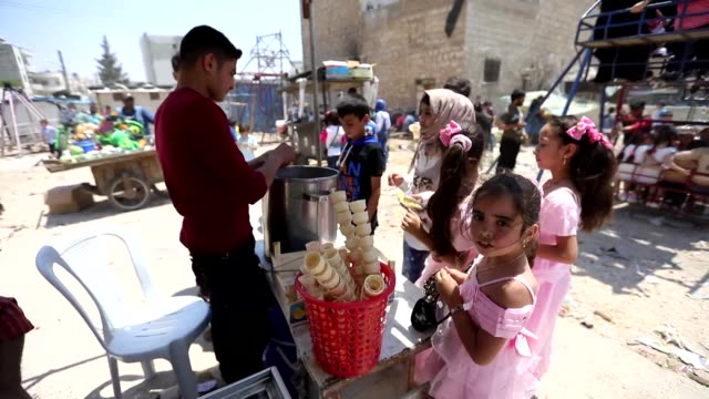 syrians celebrate eid alfitr the festival marking the end of the holy month ramadan in the rebel held idlib province - eid ul fitr stock videos & royalty-free footage