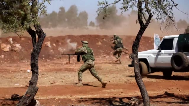 syrians fighters attend a mock battle in anticipation of an attack by the regime on the idlib and its surrounding area during a graduation of new... - battle stock videos & royalty-free footage