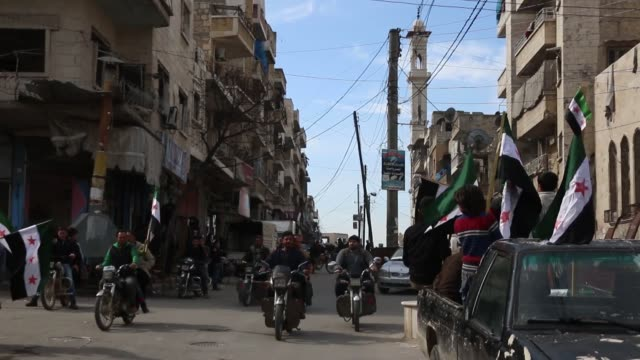 Syrians hold placards during a protest demanding the removal of Assad regime's siege of Eastern Ghouta at the Idlib's Maarrat alNuman District in...