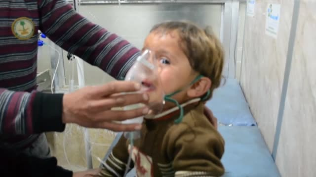 syrians including children receive treatment at a local hospital following an alleged chlorine gas containing barrel bomb attack by assad regime... - az zawiyah stock videos & royalty-free footage
