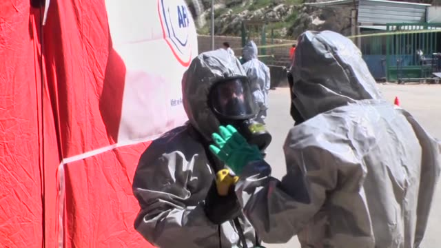 Syrians injured when a regime warplane carried out a alleged chlorine gas attack in Syria's northwestern Khan Shaykhun district of Idlib are brought...