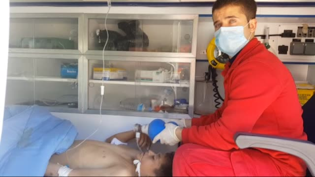 Syrians injured when a regime warplane carried out a chlorine gas attack in Syria's northwestern Khan Shaykhun district of Idlib are brought to the...