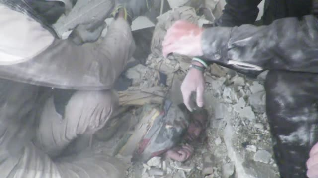 syrians inspect debris of collapsed building adter war crafts belonging to the syrian and russian army carried out airstrikes over residential areas... - air raid点の映像素材/bロール