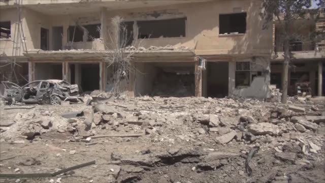 Syrians inspect the scene and damaged Sheikh Shoaib mosque after regime forces hit a market in oppositionheld Binnish town north of Idlib Syria on...