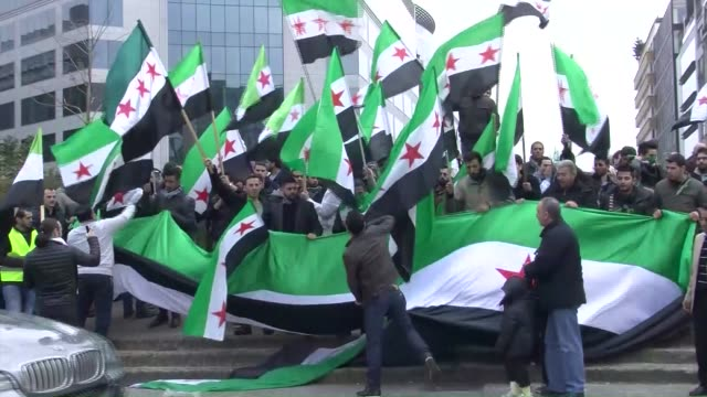 syrians living in belgium, stage a protest against assad regime on the occasion of the fifth anniversary of the syrian conflict, in front of the... - anniversary stock videos & royalty-free footage