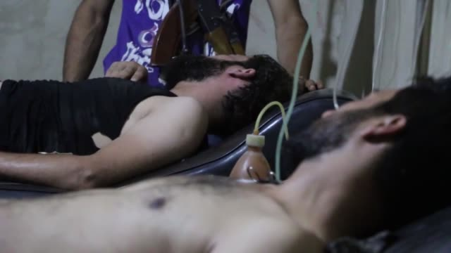 Syrians receive treatment following a chlorine gas attack by Assad regime forces in Jobar town of Damascus Syria on July 31 2015