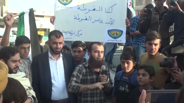 syrians stage a demonstration to protest the eastern ghouta siege at maarrat al-nu'man district, which is located inside one of the recently... - nu stock videos & royalty-free footage