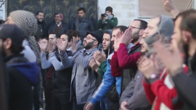 syrians stage a protest against assad regime forces' and its supporters' violation of cease fire after friday prayer at the maarrat alnu'man district... - nu stock videos and b-roll footage
