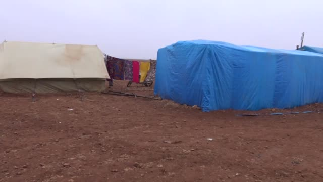 Syrians struggle for life among harsh conditions by living in makeshift tents despite the cold weather as Russian army continue to stage airstrikes...