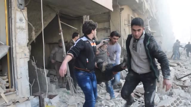 syrians take part in the search and rescue operation following the syrian regime's airstrikes over civilians in residential areas at the douma town... - civilian stock videos & royalty-free footage