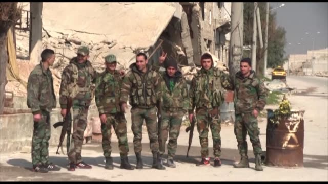 syrians waved national flags and soldiers patrolled in neighbourhoods of the northern city of aleppo friday after syrian army forces replaced the... - people's protection units stock videos & royalty-free footage
