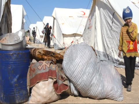 syrians who flee the attacks of syrian and russian air forces, shelter at tents and try to live their lives with humanitarian aid send by turkey, at... - orthographic symbol stock videos & royalty-free footage