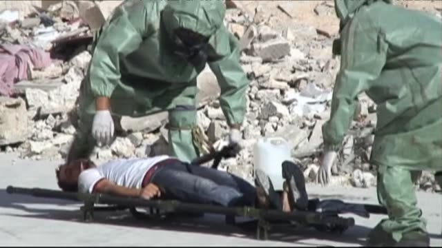 syria's brutal war and fear of chemical attacks have forced a group of volunteers to organize a rudimentary system to respond to a chemical attack... - chemical stock videos & royalty-free footage
