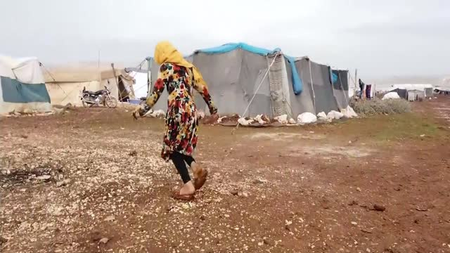 syria's children report series: ten years on from start of civil war; idlib, syria; various shots of syrian children sat in rubble next to cuddly... - war and conflict video stock e b–roll