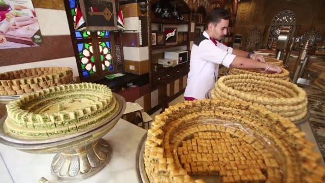 Syria's grinding conflict has brought bitterness to producers of the country's renowned Middle Eastern sweets but after years of struggle they say...