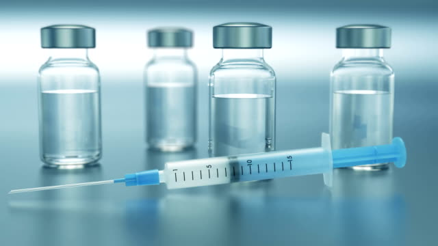 Syringe and vials medical background