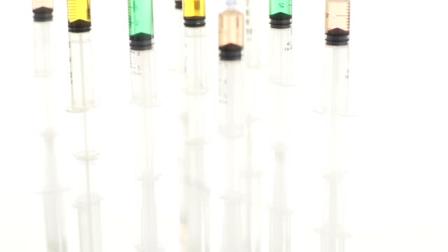 HD: Syringes On A Glass Surface