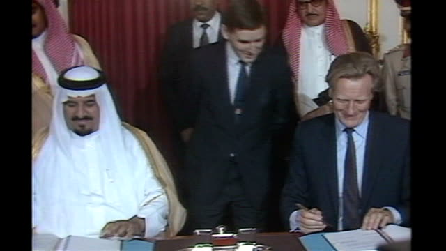 Blair government guilty of 'abject surrender' for halting inquiry TX ENGLAND London Lancaster House INT Michael Heseltine MP signing 'Al Yamamah'...
